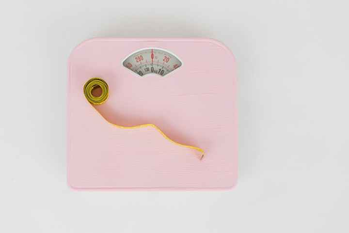 scales and measuring tape on white floor